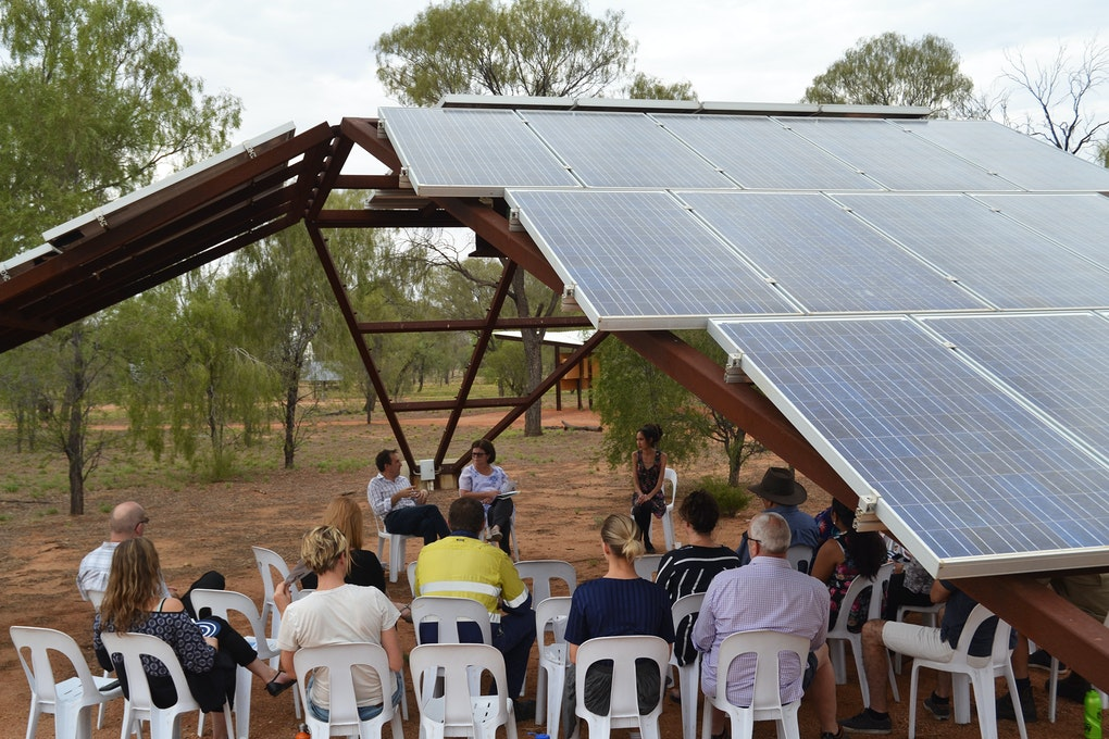 Guests gathered under the solar arrays to hear reflections on the development of this international gem.